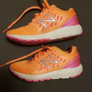 New balance kids 12 orange and pink sneakers